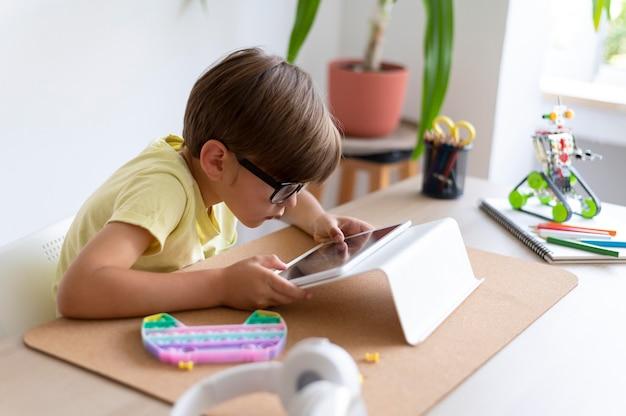 Medium shot kid with tablet