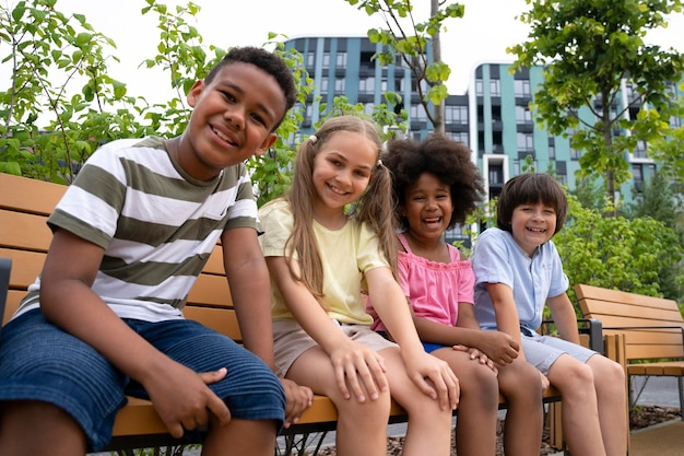 Medium shot kids sitting on bench