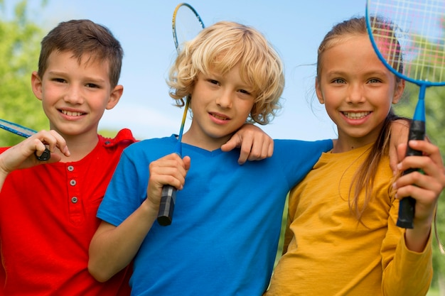 Medium shot kids with badminton racket