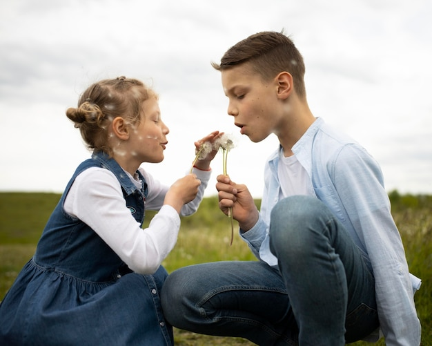 Medium shot kids with dandelions