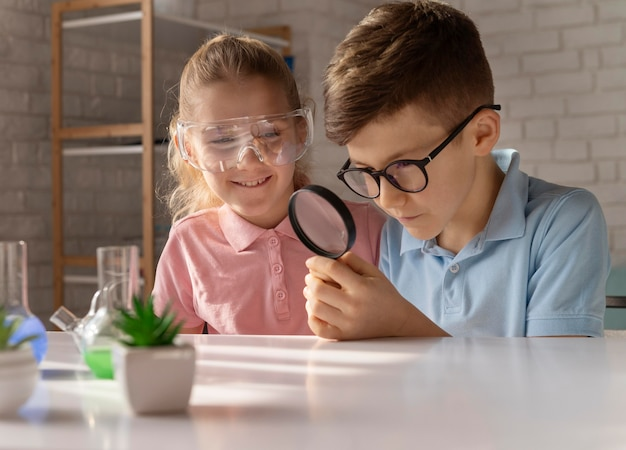 Medium shot kids with magnifying glass