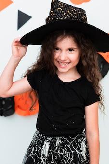 Medium shot of little girl smiling