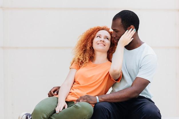 Medium shot of loving interracial couple