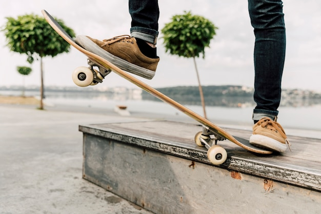 Medium shot of man balancing on skateboard