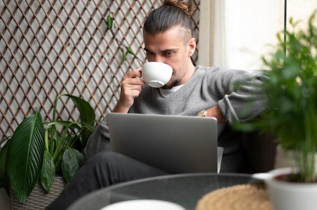 Medium shot man drinking coffee cup
