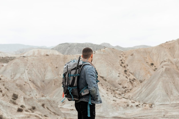 Medium shot man holding backpack