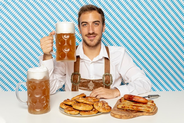 Medium shot of man holding beer pint