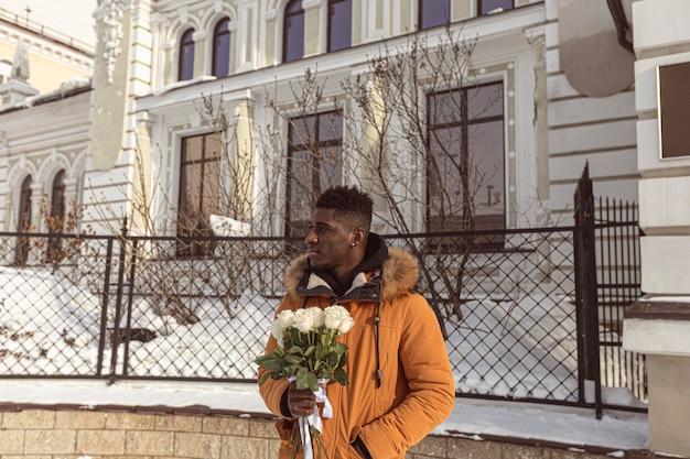 Medium shot man holding bouquet