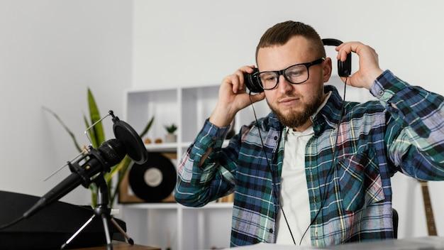 Medium shot man holding headphones