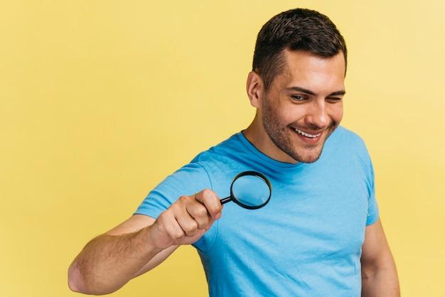 Medium shot man holding a magnifier