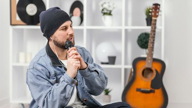 Medium shot man holding microphone