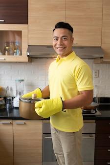 Medium shot man holding pot