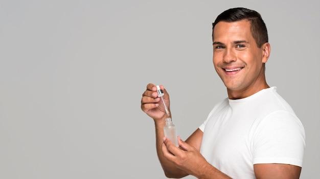 Medium shot man holding serum