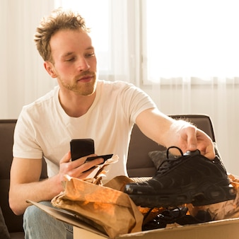 Medium shot man holding shoe