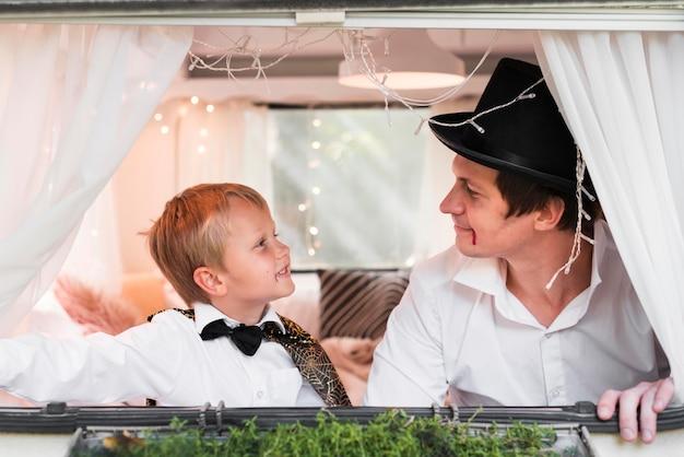 Medium shot man and kid with costumes