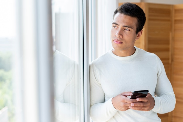 Medium shot of man looking outside