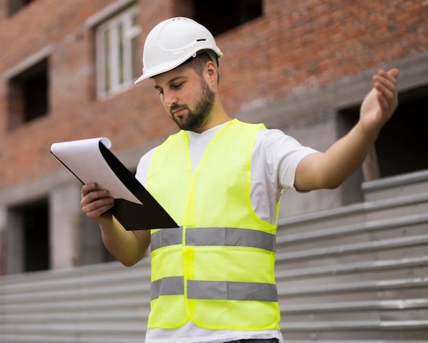 Medium shot man looking at project