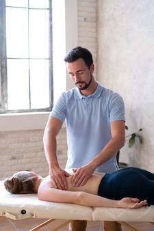 Medium shot man massaging back