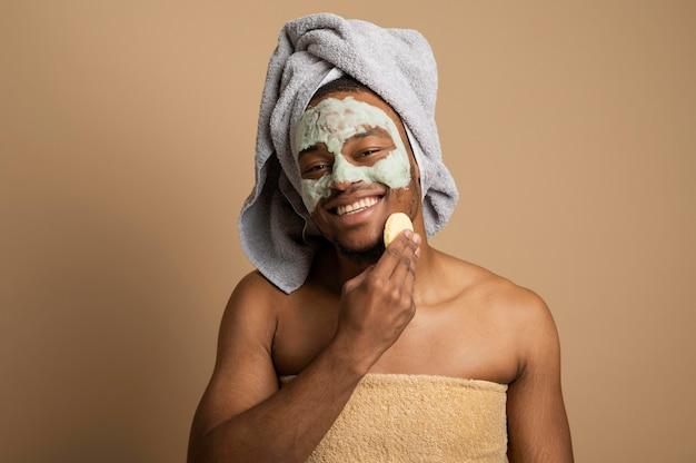 Medium shot man massaging face