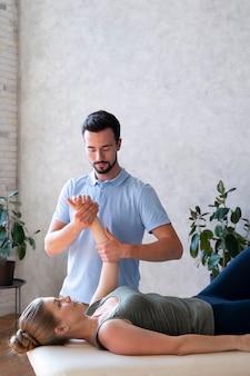 Medium shot man massaging patient