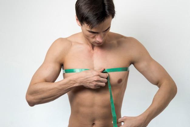 Medium shot man measuring chest