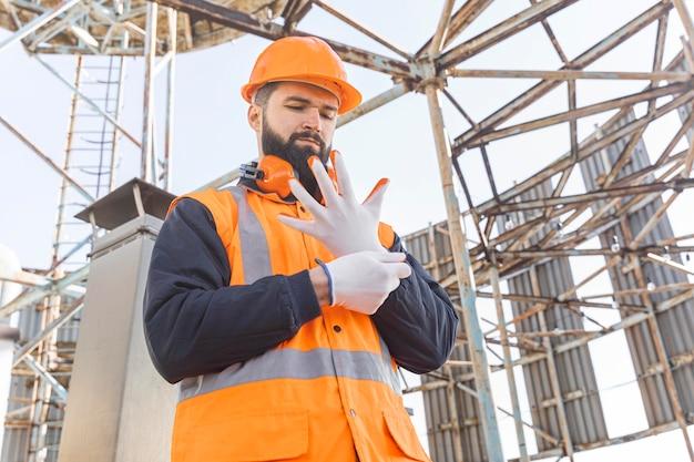 Medium shot man putting on gloves