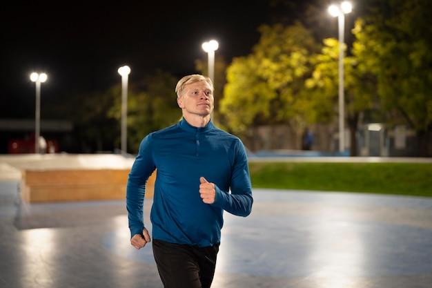 Medium shot man running outdoors