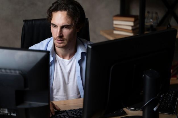 Medium shot man sitting at desk