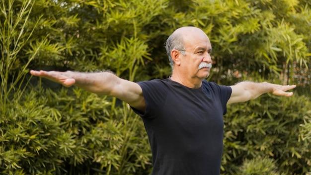 Medium shot of man stretching his arms