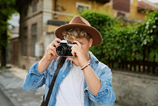 Medium shot man taking photos