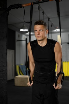 Medium shot man training at gym