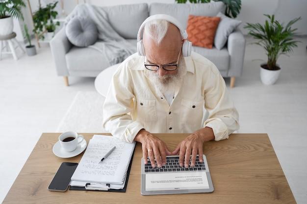 Medium shot man typing on tablet