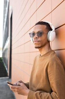 Medium shot man wearing headphones