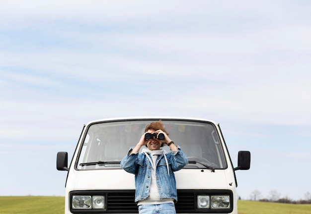 Medium shot man with binoculars