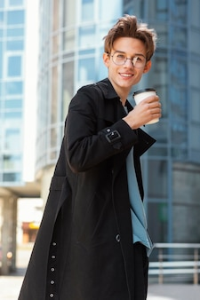 Medium shot man with coffee cup