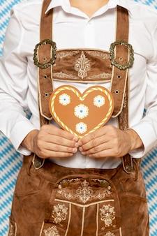 Medium shot of man with gingerbread