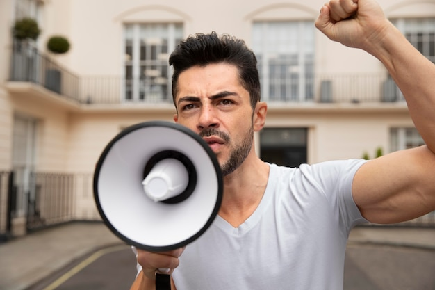 Medium shot man with megaphone