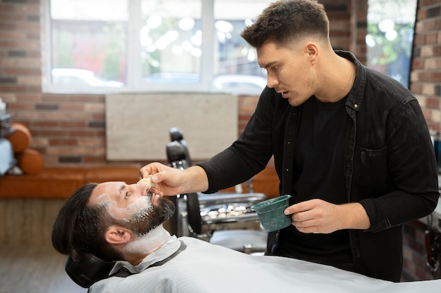 Medium shot man with shaving cream