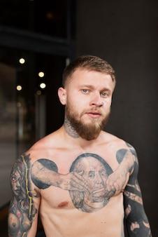 Medium shot man with tattoos outdoors