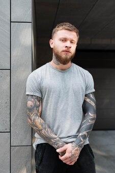 Medium shot man with tattoos