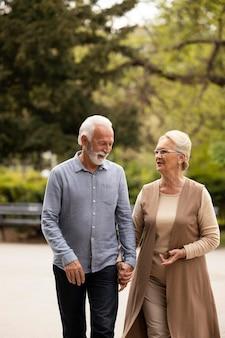 Medium shot man and woman holding hands