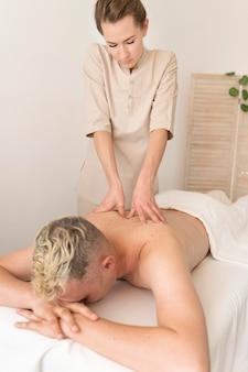 Medium shot masseuse working