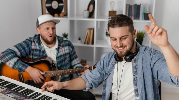 Medium shot men composing music