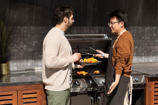 Medium shot men making barbecue