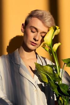Medium shot model holding flowers