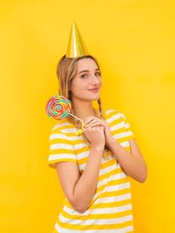 Medium shot model holding lollipop