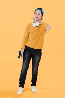 Medium shot of modern boy with skateboard