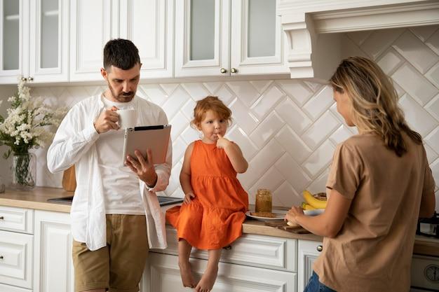 Medium shot modern family with tablet