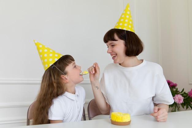 Medium shot mother and girl celebrating