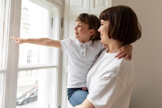 Medium shot mother holding girl